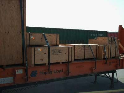 packing crates stacked and strapped down along a shipping container
