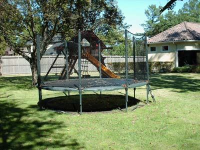 trampoline in a back yard